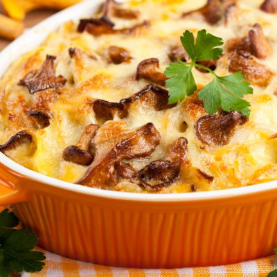 Potato casserole with chanterelle mushrooms and cheese, close up